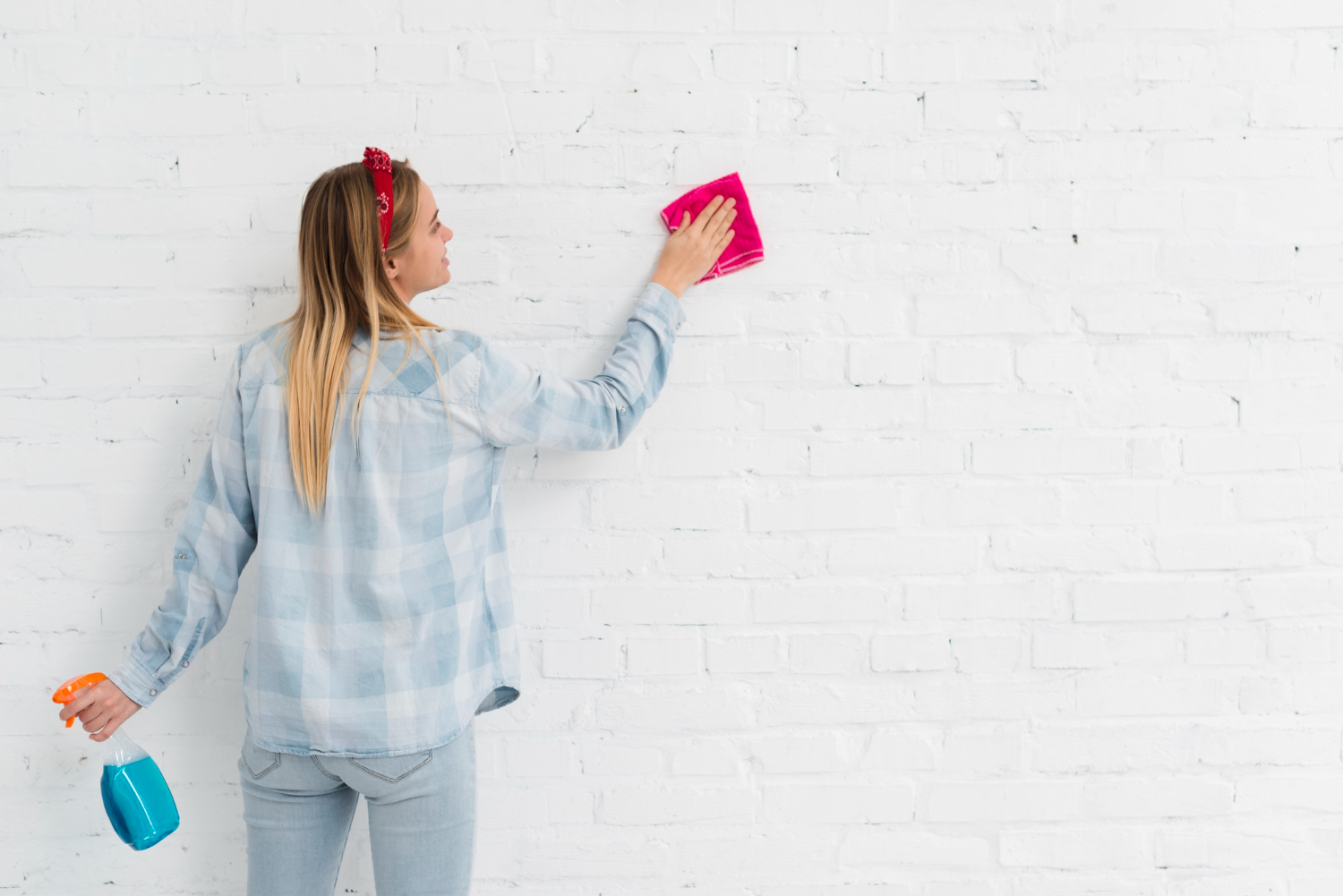 front-view-woman-cleaning-wall